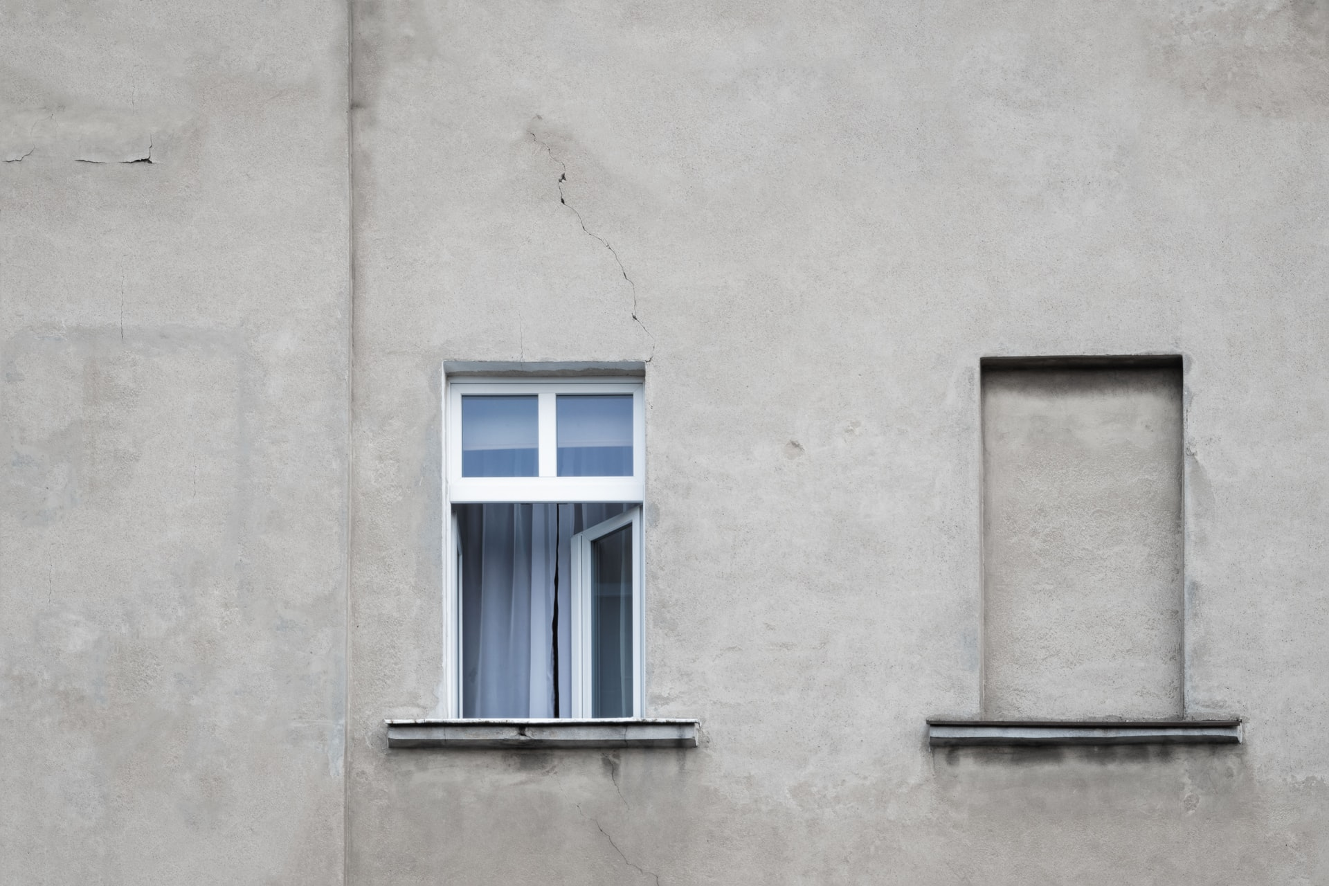 Exterior wall with cracks around the window