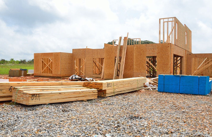 New home under construction using stacks of lumber.
