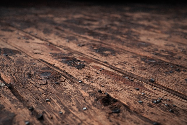 Water droplets on an old wooden floor