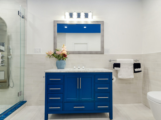 A bathroom with fixtures placed above the mirror